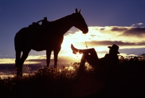 TWE_OR_110127-0001.jpg  North America,USA,Oregon,Cowboy and His Horse at rest in Sunset